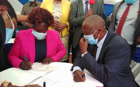 Board Chair Dr. Lily Kisaka signing an MOU for the ABDP on 12-10-2020 at ABDP Headquarters in Nyeri, Looking on is the Fisheries PS, Prof. Ntiba.